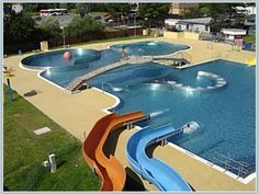 Cool outdoor swimming pool with water slides