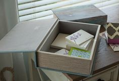 A set of clever boxes that look like books  make lovely storage containers for the desk top.