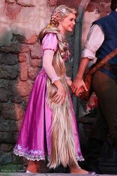 Rapunzel and Flynn meet their fans! I just love it when the characters hold hands and cuddle and do cutsie things like that it makes it more real  <3