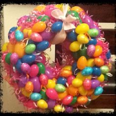 Happy Easter present for friends. Cut out a card board circle, hit glue about 130 eggs and decorate with play grass. Easy peasy and super cute. Dollar store craft, $10 whole dollars!