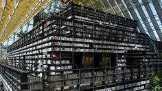 Towering Library Covered In Books Proves That Hardcovers Are Still Good For Something