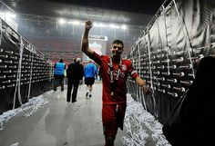 Steven Gerrard walks back down the tunnel after the Carling Cup celebrations.