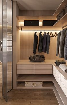 Compact and refined, this walk-in wardrobe fuses function and form. Matt black fixtures contrast the soft light woodgrain cabinetry. Integrated lighting adds visibility to the dark closet while also highlighting the shape of the joinery. Walk In Closet Design, Bedroom Closet Design, Closet Designs, Bathroom Design Luxury, Home Interior Design, Casa Magna, Wardrobe Room, Modern Closet, Dressing Room Design
