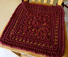 This chair pad is a large granny square with crocheted ties
