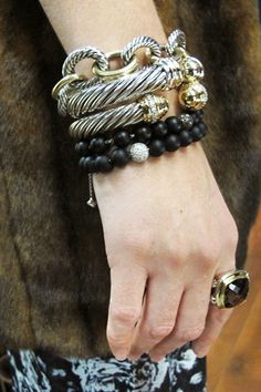 . We stacked five wonderfully weighty — and very different — bangles, chains, and beaded loops of precious sterling silver, 18-karat yellow gold, pavé diamonds, and black onyx