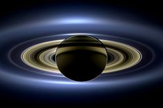 The Day the Earth Smiled (contrast enhanced) //  On July 19, 2013, in an event celebrated the world over, NASA's Cassini spacecraft slipped into Saturn's shadow and turned to image the planet, seven of its moons, its inner rings -- and, in the background, our home planet, Earth.