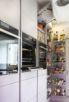 Kitchen Design Specifications: Masterclass units - Sutton Silk H Line Light Grey Aluminium effect handle rail  Other: NEFF appliances: Slide & Hide ovens, Compact Oven with Microwave Dimable colour changing feature lighting suite