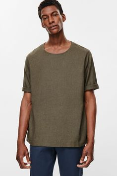 Made from pure silk with a bobbly quality for added texture, this t-shirt has been designed with a standard, straight fit and shape. It is completed with short, folded sleeves, a round neckline and subtle, double-stitched finishes.