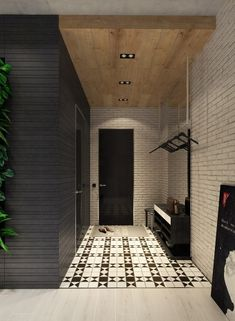 Playfully matched patterns take this space away from the more brutalist style. Striped wall texture, patterned tile floors and modern white brick all work together to create a bit of warmth without sacrificing the overall sleek look or atmosphere.