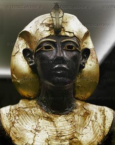 EGYPT SCULPTURE 2ND-1ST MILL.BCE The Royal Ka, guardian spirit of Tutankhamun. Statue, red wood, gilded bronze. 1352 BCE, 18th dyn. From the tomb of Tutankhamun, Thebes. Close-up of 08-01-02/56 Egyptian Museum, Cairo, Egypt