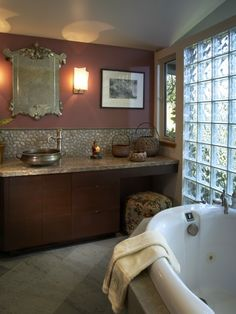 Backsplash for Bath is correct height behind sink fixture. It works cohesively with the mauve paint.
