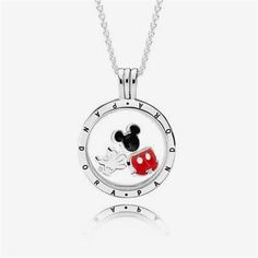 PANDORA | PANDORA Disney Mickey Floating Locket Set | Add a charming addition to your wardrobe with this playful locket gift set. His trousers in miniature, white enamel glove and his unmistakable icon all come together to create a whimsical gift set available online or in concept stores. #JewelryPandora