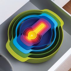 colorful measuring cups and spoons with mixing bowls