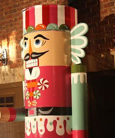 These AMAZING nutcrackers are almost two stories tall!  It looks like they may be made from those big cardboard tube/pipe things....