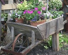 Old Wooden Wheelbarrow with Potted Plants Rustic Gardens, Outdoor Gardens, Outdoor Plants, Outdoor Fun, Outdoor Spaces, Outdoor Living, Wheel Barrel Planter, Wagon Planter, Wooden Wheelbarrow