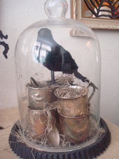 STARSHINE CHIC : Happy Halloween! Cloche w/ silver baby cups/spoons, moss and a raven.