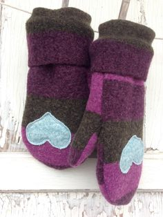 These mittens have come out of a love affair with felted wool.     The wool in this pair of mittens has been felted making it a very thick, soft and