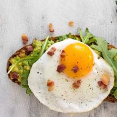 In this satisfying Avocado Toast with Egg, Arugula & Bacon recipe, try full-flavored, high-fiber bread, like a hearty slice of German-style rye or seeded multigrain from your favorite bakery. To turn this into a breakfast on-the-go, swap the toast for a whole-wheat English muffin or wrap.