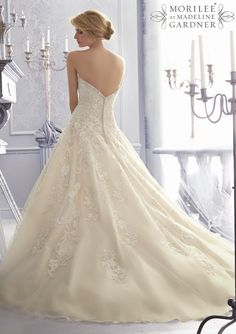 I suggest that you be firmly seated before reading this post because today's array of wedding dresses will knock you off your feet with their sheer gorgeousness. If you're a sucker for all things pretty, you'll find plenty of inspiration in the beautiful Fall 2014 bridal collection from Mori Lee by Madeline Gardner. In this read more...