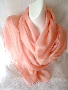 A beautiful and soft plain coloured silk scarf. A lovely smooth feeling on the skin. 100% Silk, an excellent scarf for your collection.