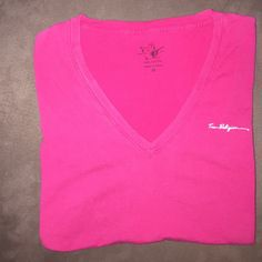 True Religion V-neck tee size M True Religion V-neck tshirt bright pink size M. Natural slight pelling happening from washes. (See 2nd pic) Also the variation in color from top to bottom is natural-anyone who buys True Religion knows this about the brand. Have questions? Or free to make an offer! Happy Poshing! Xo! True Religion Tops Tees - Short Sleeve