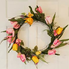 Beautiful and rustic grapevine Easter Wreath, painted white and adorned with beautiful and vibrant Spring Tulips. This wreath would look wonderful greeting your guests. Perfect Spring Wreath to welcome in the warm season! Summer Wreath, Spring Wreaths, Holiday Wreaths, Tulip Wreath, Floral Wreath, Wreaths For Front Door, Door Wreaths, Country Wreaths, Rustic Wreaths