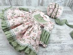 Prairie Dress Grrrn and Pink Dress and Bonnet Floral DressThis is a 2 piece set that comes with an adorable bonnet and beautiful dress Baby Frocks Designs, Kids Frocks Design, Green Dress, Pink Dress, Dress Barbie, Barbie Doll, Puffy Dresses, Dresses Dresses, Pageant Dresses