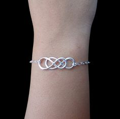 Looks like REVENGE>>>>>Infinity - Sterling Silver Double Infinity Bracelet - Eternity Bracelet, Simplicity, Forever Bracelet, Love, Bridal Party. $48.00, via Etsy.