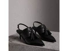 Smooth leather sandals with a penny loafer-style upper. Animated with a tassel detail, the Italian-made design features a kitten heel and pointed toe for a sharp silhouette.