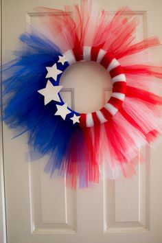Patriotic Of July Decorative Wreath LInk doesn't have this item anymore but you could probably make it red, white. and blue Tule a wreath shape and some wooden stars 4th Of July Celebration, 4th Of July Party, Fourth Of July, 4th Of July Wreath, Holiday Wreaths, Holiday Crafts, Holiday Fun, Patriotic Crafts, July Crafts