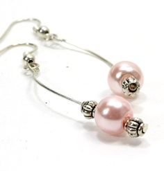 Items similar to Long Pink Pearl Earrings with Curved Wire. Light Pink Pearl with Two Silver Accent Beads. Curve Earrings with One Pink Pearl. Long Earrings on Etsy Pink Pearl Earrings, Gems And Minerals, Etsy Store, Jewelry Ideas, Jewerly, Jewelry Watches, Wire, Pendants, Necklaces