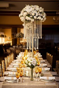 Wedding Reception: Glamorous Centerpieces with Sparkly Dangling Crystals. To see more: www.modwedding.com