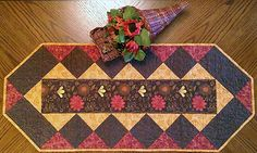 """Fabulous Strip Table Runner By Laird, Cathey  - 15in x 35in. Uses Creative Grids CGR5.Project Time: 2-6 Hour. Fabric Type: Fat Quarter Friendly. Project Type: Home.  CLP patterns are printed on 8-1/2"""" x 11"""", anti-copy card stock. Because they are customized with your shop's Bill-to account name, phone number and web site, they are not returnable.."""