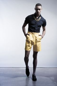 Yellow high-waisted shorts, black short-sleeve button-down. Jewelry makes this work!