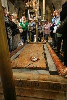 Inside the Church of the Holy Sepulchre, Jerusalem: The Stone of Anointing, also known as The Stone of Unction, which tradition claims to be the spot where Jesus' body was prepared for burial by Joseph of Arimathea.