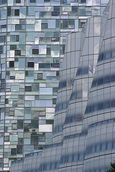 NYC. Manhattan. Gehry\'s iac building reflecting its new neighbor, Nouvel\'s 100 11th ave condos.
