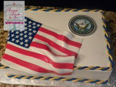 Military retirement cake.  The flag was fondant and the Navy seal is an edible image.  The roping is blue twisted with gold.