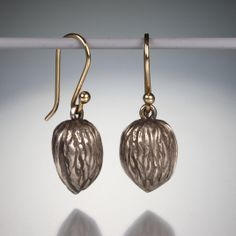 """A pair of sterling silver walnuts with 14k yellow gold earwires. Total length 3/4"""""""