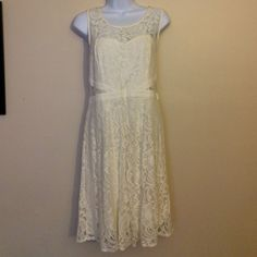 Cream Lace Dress Very beautiful address for any occasion. A cream laced dress with zip back. American Rag Dresses