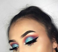 metallic ice blue eyeshadow blended out with purple shadow