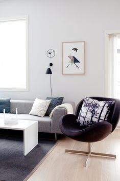 Just that single forest-themed throw pillow adds so much depth and personality to this Scandinavian living room. The sofa and coffee table are from Bolia, the lower wall lamp is the Bestilte lamp from Gubi and the square one above it is a POV light from Note Design in Sweden. The armchair is from Denmark's BoConcept. No word on where the pillow is from. Notes Design, Scandinavian Living, Boconcept, Nordic Style, Sweden, Personality, Armchair, Decor Ideas, Couch