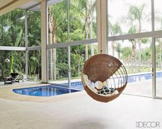 The pool extends into the living area; the chaise longue is by Le Corbusier, and the hanging chair is by Armando Cerello.