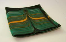 Combed glass, manipulated by artist at 1600 degrees to achieve this striking look. Gertie Zeiter