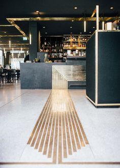 """Build Inc Architects adds brass """"veins"""" to Munich bar interior:"""