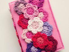 "Pretty flower pattern: ""Make 12dc in a magic circle, change colour, then *5dc in same stitch, 1sc in next* around."""