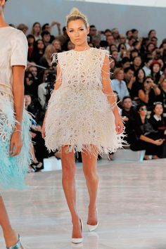 Kate Moss is utter perfection in LV Spring 2012. The dress is a delicious piece of jet-puffed confectioner's sugar fashioned from lace and feathers.