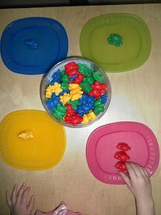 Colour sorting using Bear family manipulatives and coloured plates.