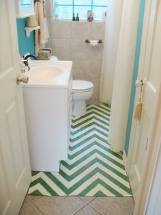 ...a painted bathroom rug from dropcloth. this would solve my NASTY white tile problem...
