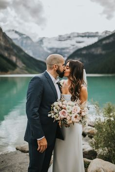 This couple had an intimate lake side ceremony outdoors at the Fairmont Chateau Lake Louise. The bride held a garden style bouquet of blush and ivory blooms with a touch of boho pampas grass. The flowers included Quicksand roses, zinnias, snowberries, strawflowers and more. Photo: @mintphotoca  Planner: @momentsbymadeleine   #lakelouisewedding #lakelouisealberta #lakelouiseelopement #blushandwhitebouquet #calgaryflowers #snowberries #pinkstrawflower #pampasgrass #outdoormountainwedding… Bridesmaid Bouquet, Bridal Bouquets, Fairmont Chateau Lake Louise, Flower Girl Bouquet, Lake Side, Bouquet Toss, Pampas Grass, Zinnias, Garden Styles