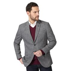 This classic single breasted jacket from The Collection is perfect for introducing heritage style to a smart wardrobe. Featuring a classic textured salt and pepper finish, this staple piece has a contrasting patterned lining and has been designed with two button fastenings. Also available in big and tall sizes.